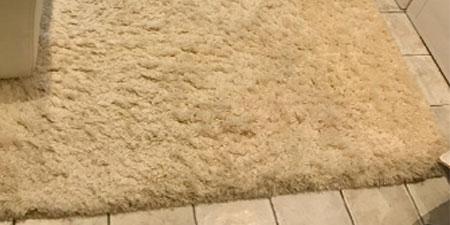 Reconstrucción alfombra partida en dos
