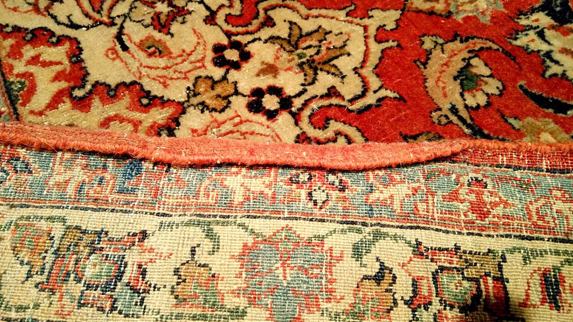Restauracion lateral alfombra Kashan antes