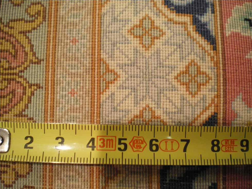 Nudos de una alfombra en el reverso