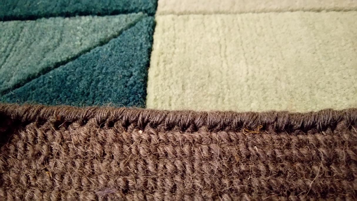 Restauración alfombra mordedura de perro después
